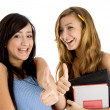 Female students showing thumbs up — Stock Photo