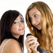Stock Photo: Smiling young models singing in mic