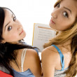 Back pose of young students with book — Stock Photo