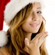 Cute teenager girl wearing christmas hat — Stock Photo