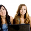 School girls with laptop, smiling — Stock Photo #1672639
