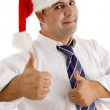 Businessman in santa hat cheering up — Stock Photo #1672959