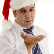 Handsome businessman with open palm — Stock Photo