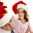 Father and his daughter in santa cap — Stock Photo #1673061