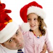 Father and his daughter in santa cap — Stock Photo