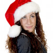 Female in christmas hat looking upwards — Stock Photo #1673239