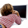 Back pose of little child watching tv — Stockfoto