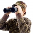 Front view boy viewing through binocular - Stock Photo