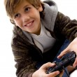 Stock Photo: Amused boy playing videogame