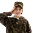 Saluting young boy in front of camera — Stock Photo