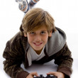 Smiling young boy playing video game — Stock Photo
