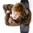 Ariel view of boy sitting on skateboard — Stok fotoğraf