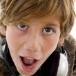 Close up of shocked boy with headphones — 图库照片
