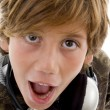 Close up of shocked boy with headphones — Stok fotoğraf