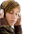 Stock Photo: Portrait of little boy tuned in music