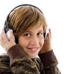 Portrait of smiling child enjoying music — Stock Photo