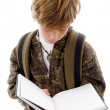 School child reading a book — Stockfoto