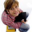 Royalty-Free Stock Photo: Boy sitting on pile of books