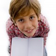 Ariel view of boy showing open book — Stock Photo