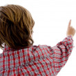 Back pose of boy pointing - Stock Photo