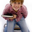 Ariel view of little boy holding books — Stock Photo