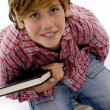Ariel view of little boy holding books — Stock Photo #1674092