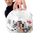 Man holding disco ball like a globe - Stock Photo