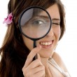 Female looking through magnifying glass — Stock Photo