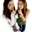 High angle view of girls shushing — Foto Stock