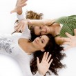 Royalty-Free Stock Photo: Lying young females showing their palms