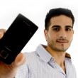 Portrait of smiling man showing mobile — Stock Photo