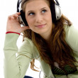 Stock Photo: Attractive female enjoying music