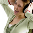 Woman shouting while listening to music — Stock Photo