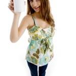 Beautiful woman holding white bottle — Stock Photo #1674807
