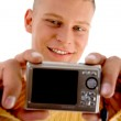 Handsome young guy with digital camera — Stock Photo #1675118
