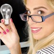 Young woman holding bulb — Stock Photo