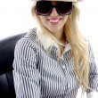 Young woman with sunglasses and hat — Stock Photo