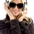 Beautiful young woman enjoying music - Stock Photo