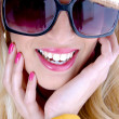 Close up of young woman in sunglasses — Stock Photo