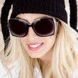 Young beauty in winter cap — Stock Photo