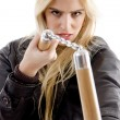 Stock Photo: Aggressive female holding nunchaku