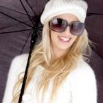 Beautiful woman holding an umbrella — Stock Photo