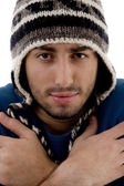 Man wearing winter cap shivering — Stock Photo