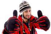 Young man in woolen outfit, thumbs up — Stock Photo