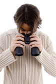 Man watching through binoculars — Stock Photo