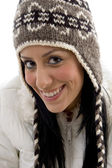 Portrait of cheerful woman in woolen cap — Stock Photo
