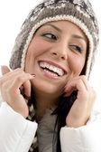 Portrait of cheerful woman in woolen cap — Stock Photo