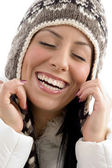 Portrait of happy woman with woolen cap — Stock Photo