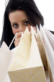 Cheerful female model with carry bags — Stock Photo
