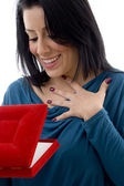 Surprised woman looking in jewellery box — Stock Photo